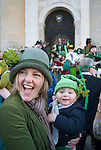 Oxford Uk. Wednesday 1st May 2013. Revellers a young mother and son dressed in green celebrate May Day on the steps of the Sheldonian Theatre. ..