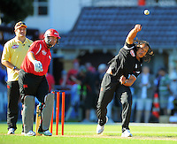 Tana Umaga bowls past Craig McMillan as umpire Richie McCaw looks on. Fill The Basin for Christchurch fundraising cricket match - Canterbury Invitational XI v Wellington Legends XI  at Hawkins Basin Reserve, Wellington, New Zealand on Sunday, 13 March 2011. Photo: Dave Lintott / lintottphoto.co.nz