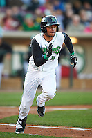 Dayton Dragons second baseman Ronald Bueno (4) runs to first during a game against the Great Lakes Loons on May 21, 2015 at Fifth Third Field in Dayton, Ohio.  Great Lakes defeated Dayton 4-3.  (Mike Janes/Four Seam Images)