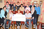 Helen O'Sullivan, Killorglin and District Mental Health Association, pictured as she accepted a cheque for ?1,695 in Killorglin on Monday night, from Michael and Vincent O'Cionnor, the O'Connor family and friends group Beaufort, who Climbed Carrauntuohill recently to raise the money. Also pictured are Sheila Kelliher, Gavin O'Conor, Fr Liam O'Brien, Aoife O'Connor, Hannah O'Connor, Joanna Fitzpatrick, Stephen O'Grady, Margaret Foley, Christy Fenton, Michael Hassett, Noreen Ahern and Sandra Clifford.............................................