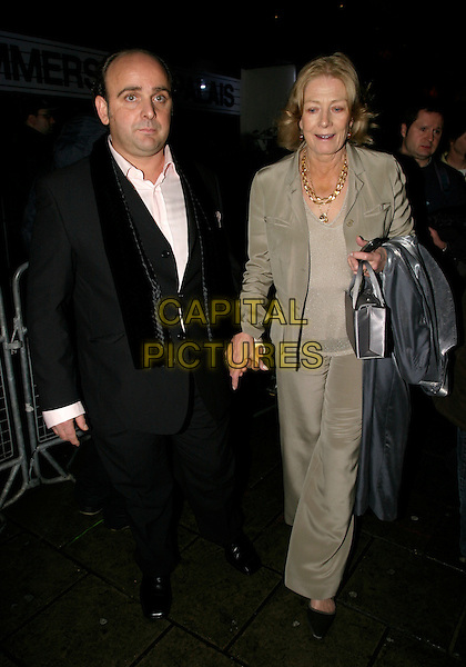 VANESSA REDGRAVE & GUEST.The British Independent Film Awards at Hammersmith Palais, London, UK..November 30th, 2005.Ref: AH.full length grey gray suit silver bag holding hands.www.capitalpictures.com.sales@capitalpictures.com.©Capital Pictures