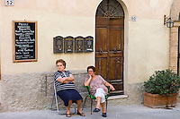 Local women sitting out in Montalcino, Val D'Orcia,Tuscany, Italy