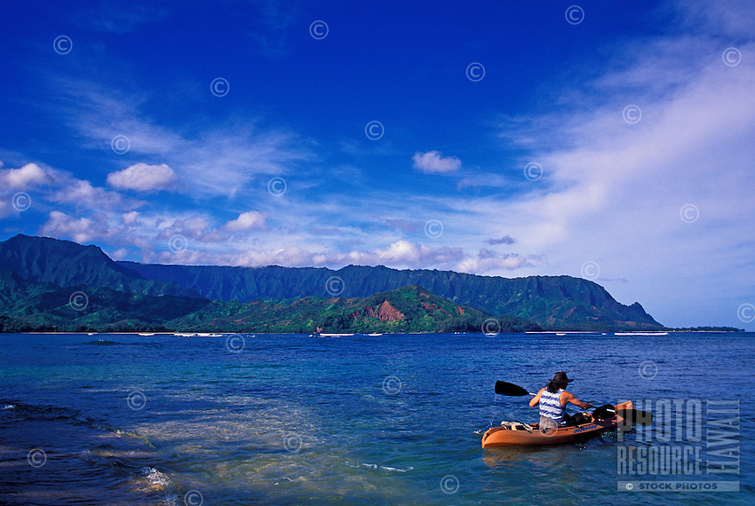 Man kayaking on Hanalei Bay, Kauai