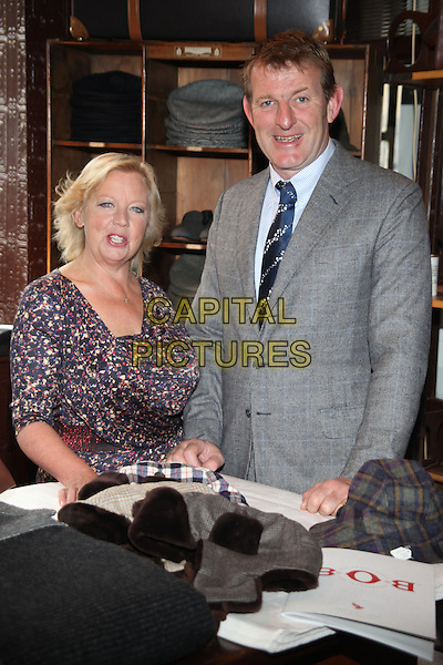 Deborah Meaden and husband, Paul Farmer .officially opens the 'Best of British' event in London, England, UK, .5th October 2012..half length print dress red black grey gray suit tie .CAP/JEZ  .©Jez/Capital Pictures.