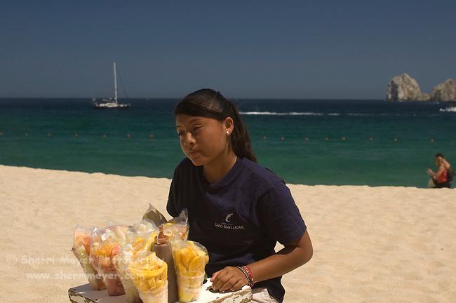 Female beach vendor on the beach (playa), Cabo San Lucas, Baja California, Mexico