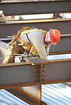 A steel worker tightens down bolts on newly placed beams at the new patient tower at the Williamsport Regional Medical Center.