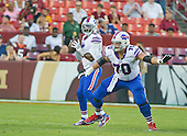 Buffalo Bills quarterback Tyrod Taylor (5) looks to pass as Bills center Eric Wood (70) defends for him in pre-season action against the Washington Redskins at FedEx Field in Landover, Maryland on Friday, August 26, 2016.  The Redskins won the game 21 - 16.<br /> Credit: Ron Sachs / CNP