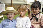 ROBERT WALKER, 4, of Coram  (left),  JULIAN LYNN ZOLL, 6, of Levittown (center), and MADELYN WALKER 7, of Coram (right), wear clothes of American Civil War era while portraying family members of Union soldiers at Camp Scott re-creation, at Old Bethpage Village Restoration, to commemorate 150th Anniversary of American Civil War, on Saturday, July 21, 2012, in Old Bethpage, New York, USA.