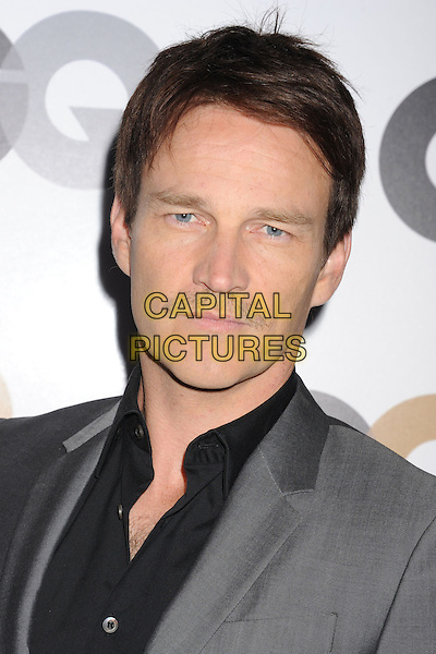 Stephen Moyer.Arriving at the GQ Men Of The Year Party at Chateau Marmont Hotel in Los Angeles, California, USA..November 13th, 2012.headshot portrait grey gray  shirt  black moustache mustache facial hair .CAP/ROT/TM.©Tony Michaels/Roth Stock/Capital Pictures