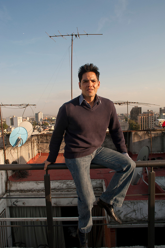 Edgar Martinez. Photo shoot for magazine cover.  Torreblanca on a rooftop in central Mexico City.