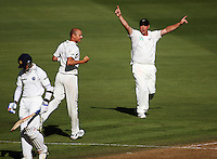 NZ's Jesse Ryder (right) celebrates Chris Martin's dismissal of Rahul Dravid during day one of the 3rd test between the New Zealand Black Caps and India at Allied Prime Basin Reserve, Wellington, New Zealand on Friday, 3 April 2009. Photo: Dave Lintott / lintottphoto.co.nz
