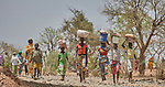 People walking to a weekly market in Gidel, a village in the Nuba Mountains of Sudan.