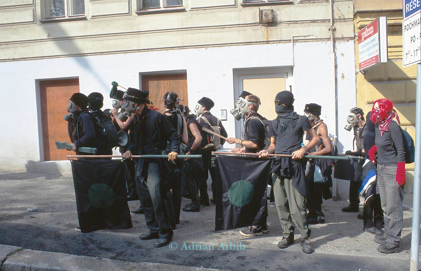 An Anarchist anti-globalisation group march on a Police barricade during the IMF/World Bank conference...Sept. 2000