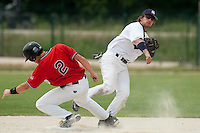 21 May 2009: Romain Scott-Martinez throws a ball to first base for the double play during the 2009 challenge de France, a tournament with the best French baseball teams - all eight elite league clubs - to determine a spot in the European Cup next year, at Montpellier, France.