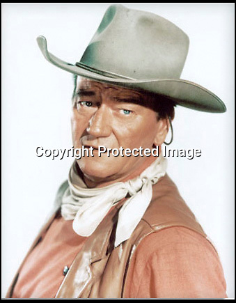 BNPS.co.uk (01202 558833)<br /> Pic: NateD.Sanders/BNPS<br /> <br /> ***Please Use Full Byline***<br /> <br /> John Wayne wearing the Cowboy hat.<br /> <br /> The iconic cowboy hat that John Wayne wore in six major western films has emerged for auction and is set to fetch £17,000.<br /> <br /> The felt accessory was worn by the actor in 'The Comancheros', 'McClintock', 'The Sons of Katie Elder', 'El Dorado', and 'The Undefeated.'<br /> <br /> The famous star burst into Hollywood in 1930 and he featured in around 170 movies throughout his career.<br /> <br /> He worked alongside his stunt double, Chuck Roberson, for more than 30 years and gave him the hat as a present.