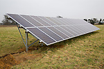 Array of PV photovoltaic solar panels stands in a field, Shottisham, Suffolk, England
