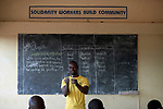 Emmanuel Patrick Kango teaches a group of workers on a church-sponsored farm in Riimenze, South Sudan. The farm is run by Solidarity with South Sudan and provides food for students at a teacher training college, residents of a Congolese refugee camp, and displaced South Sudanese who live in a camp for internally displaced persons that formed around the Our Lady of Assumption Catholic Church in Riimenze. Kango is a graduate of the Solidarity Teacher Training College in Yambio.