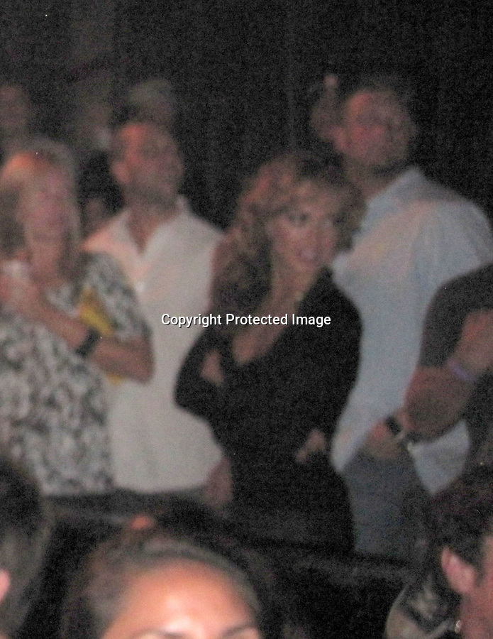 """..10-19-09 .Exclusive Monday Night ..Karina Smirnoff partying with her new man Brad Penny who's a. Pitcher for the San Francisco Giants. Chuck Liddell was also with them at the table. The couple went to watch the 1980's cover band Steel Panther at the key club in Hollywood. Tmz reported, """"The """"Dancing with the Stars"""" pro -- who just broke up with ex-fiance Maksim Chmerkovskiy -- was all over the baseball player during the Steel Panther show at the Key Club..She may be a professional hip-shaker, but the only dancing these two were doing was with their tongues.""""..AbilityFilms@yahoo.com.805-427-3519.www.AbilityFilms.com"""