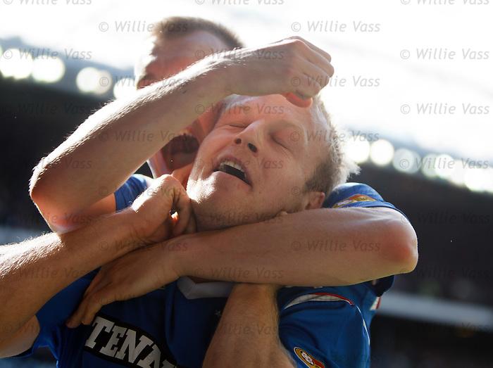 Steven Naismith celebrates as Gregg Wylde has him in a headlock
