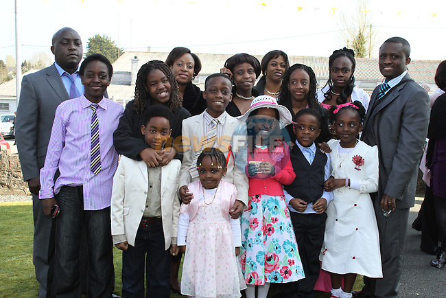 Daniel Shamavu with his family at Tullyallen NS. Confirmation...(Photo credit should read Jenny Matthews www.newsfile.ie)....This Picture has been sent you under the conditions enclosed by:.Newsfile Ltd..The Studio,.Millmount Abbey,.Drogheda,.Co Meath..Ireland..Tel: +353(0)41-9871240.Fax: +353(0)41-9871260.GSM: +353(0)86-2500958.email: pictures@newsfile.ie.www.newsfile.ie.