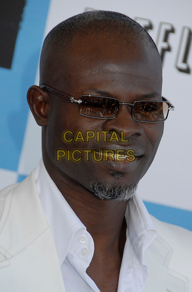 DJIMON HOUNSOU .The 2007 Independent Spirit Awards held at the Santa Monica Pier, Santa Monica, California, USA..February 24th, 2007.headshot portrait goatee facial hair sunglasses shades .CAP/ADM/GB.©Gary Boas/AdMedia/Capital Pictures
