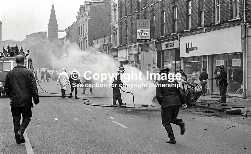 Firemen, ambulancemen & paramedics at the scene of a Provisional IRA car bomb explosion in Bradbury Place, Belfast, N Ireland. 197201210021a..Copyright Image from Victor Patterson, 54 Dorchester Park, Belfast, UK, BT9 6RJ..Tel: +44 28 9066 1296.Mob: +44 7802 353836.Voicemail +44 20 8816 7153.Skype: victorpattersonbelfast.Email: victorpatterson@me.com.Email: victorpatterson@ireland.com (back-up)..IMPORTANT: If you wish to use this image or any other of my images please go to www.victorpatterson.com and click on the Terms & Conditions. Then contact me by email or phone with the reference number(s) of the image(s) concerned.