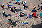 Long Beach Island, NJ - June 29, 2013 :  People soak up the sun at Beach Haven on Long Beach Island, NJ on June 29, 2013. People are returning to the beaches for the summer after recovery efforts post Hurricane Sandy.
