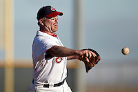 Cleveland Indians Fantasy Camp member delivers a pitch during a game at Goodyear Training Complex on January 16, 2012 in Goodyear, Arizona.  (Mike Janes/Four Seam Images)