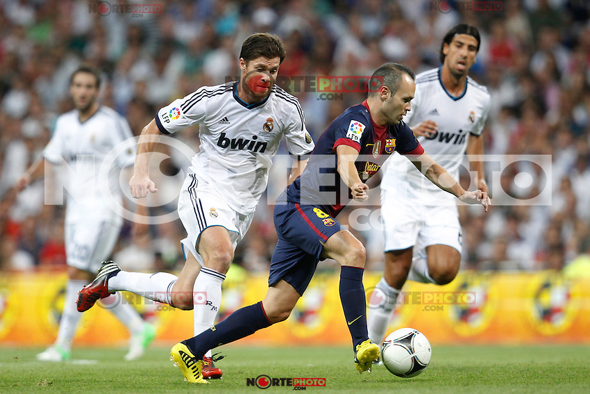 Real Madrid's Xabi Alonso and F.C. Barcelona's Andres Iniesta during Spanish Supercup 2nd match on august 29 2012...Photo: Cesar Cebolla / ALFAQUI /NortePhoto.com<br /> <br /> **CREDITO*OBLIGATORIO** <br /> *No*Venta*A*Terceros*<br /> *No*Sale*So*third*<br /> *** No*Se*Permite*Hacer*Archivo**<br /> *No*Sale*So*third*