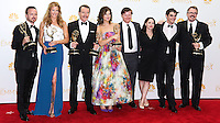 LOS ANGELES, CA, USA - AUGUST 25: Actors Aaron Paul, Anna Gunn, Bryan Cranston, Betsy Brandt, Jesse Plemons, Laura Fraser, RJ Mitte and Show Creator Vince Gilligan, winners of Outstanding Drama Series Award, Outstanding Lead Actor in a Drama Series Award, Outstanding Supporting Actor in a Drama Series Award, Outstanding Supporting Actress in a Drama Series and Outstanding Writing for a Drama Series for 'Breaking Bad', pose in the press room at the 66th Annual Primetime Emmy Awards held at Nokia Theatre L.A. Live on August 25, 2014 in Los Angeles, California, United States. (Photo by Celebrity Monitor)