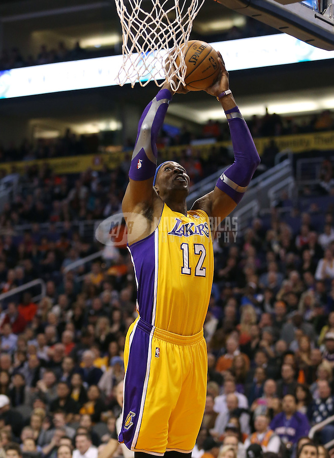 Jan. 30, 2013; Phoenix, AZ, USA: Los Angeles Lakers center Dwight Howard (12) against the Phoenix Suns at the US Airways Center. Mandatory Credit: Mark J. Rebilas-