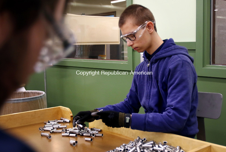 WATERBURY CT. 25 January 2017-012517SV01-Andrew Cote, 18, of Watertown, left, inspects parts while doing quality control at H&amp;T Waterbury Inc. in Waterbury Wednesday. Cote is part of The Watertown Transition Academy.<br /> Steven Valenti Republican-American