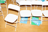 Campaign signs for Democratic presidential candidate and Minnesota senator Amy Klobuchar lay under folding chairs after the candidate spoke at a town hall campaign event at the Londonderry Senior Center in Londonderry, New Hampshire, on Wed., October 16, 2019. The event was part of a 10-county tour of New Hampshire and started the day after the 4th Democratic debate, in which analysts said Klobuchar performed well.