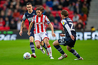 11th January 2020; Bet365 Stadium, Stoke, Staffordshire, England; English Championship Football, Stoke City versus Milwall FC; Joe Allen of Stoke City about to be tackled by Connor Mahoney of Millwall - Strictly Editorial Use Only. No use with unauthorized audio, video, data, fixture lists, club/league logos or 'live' services. Online in-match use limited to 120 images, no video emulation. No use in betting, games or single club/league/player publications