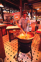 Granville Island Public Market, Vancouver, BC, British Columbia, Canada - Employee making Fresh Hand Made Fudge / Toffee Candy in Large Copper Bowl