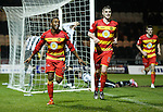 David Amoo knocks in the second goal for Partick Thistle and celebrates