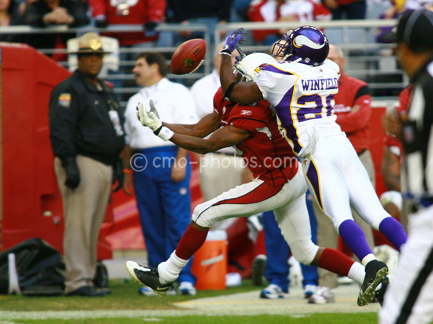 Dec 07, 2008; Glendale, AZ, USA; Minnesota Vikings cornerback Antoine Winfield (26) breaks up a pass intended for Arizona Cardinals wide receiver Steve Breaston (15) in the third quarter of a game at University of Phoenix Stadium.  Winfield was initially called for a penalty but after consultation among the referees, the penalty was reversed.  The Vikings won the game 35-14.