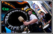 Tartan Day prepeartions - New York - Campletown Pipe Band - bass drummer William  Bruce makes the most of being in Times Square, for an appearance on Good Morning America , beamed at breakfast time to millions of american homes, as part of the Fri morning 8am slot ... Pic Donald MacLeod 02.04.04