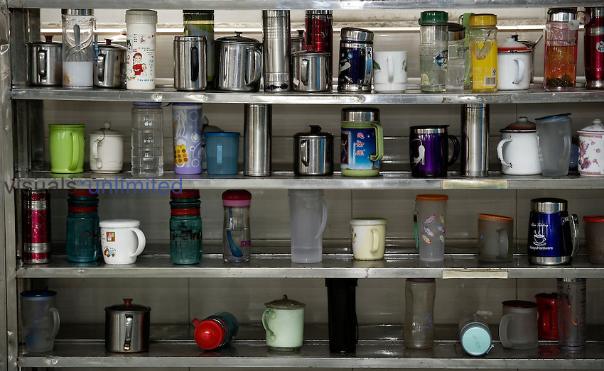 Worker tea containers on a shelf in a textile factory, Congshin, Xintang, Guangdong Province, China
