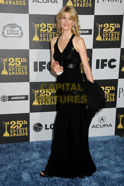 LAURA DERN.25th Annual Film Independent Spirit Awards - Arrivals held at the Nokia Event Deck at L.A. Live, Los Angeles, California, USA..March 5th, 2010.full length black = maxi dress clutch bag.CAP/ADM/BP.©Byron Purvis/AdMedia/Capital Pictures.
