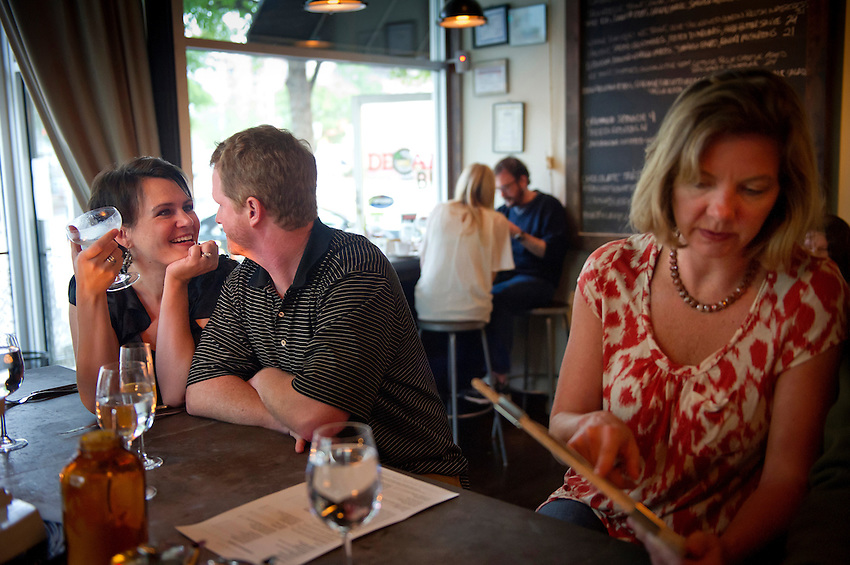 Aspen Kron, left, and her husband, Jason, at the bar at Cakes & Ale, photographed for Choice Tables on Friday, April 22, 2011 in Decatur. GA.  (Rich Addicks/Photographer) 10110950A