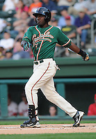 Outfielder Marcel Ozuna (34) of the Greensboro Grasshoppers, Class A affiliate of the Florida Marlins, in a game against the Greenville Drive on April 26, 2011, at Fluor Field at the West End in Greenville, South Carolina. (Tom Priddy/Four Seam Images)