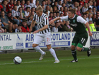 Gary Teale takes on Paul Cairney in the St Mirren v Hibernian Clydesdale Bank Scottish Premier League match played at St Mirren Park, Paisley on 18.8.12.