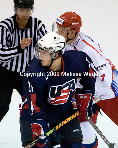 Jordan Schroeder (US - 21), Viatcheslav Kulemin (Russia - 7) - Team USA defeated Team Russia 6-1 in their second game during the 2009 USA Hockey National Junior Evaluation Camp on Wednesday, August 12, 2009, in the USA (NHL-sized) Rink in Lake Placid, New York.