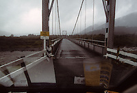 A bridge across the Fox River in Western New Zealand as seen through the windshield of a van in 1995.