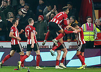 24th November 2019; Bramall Lane, Sheffield, Yorkshire, England; English Premier League Football, Sheffield United versus Manchester United; Oliver McBurnie of Sheffield United is jumped on by Callum Robinson  of Sheffield United as he celebrates after he scores in the 90th minute to make it 3-3 with George Baldock  of Sheffield United and John Lundstram  of Sheffield United and Billy Sharp  of Sheffield United close by the goal was given after a VAR decision - Strictly Editorial Use Only. No use with unauthorized audio, video, data, fixture lists, club/league logos or 'live' services. Online in-match use limited to 120 images, no video emulation. No use in betting, games or single club/league/player publications