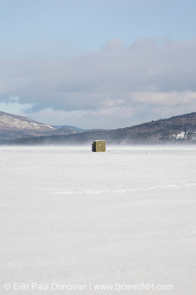 Bobhouse on Newfound Lake from the shore of Wellington State Park during the winter months.. Located in Bristol, New Hampshire USA.