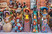 Olinda, Pernambuco State, Brazil. Tourist souvenir colourful terracotta figures.