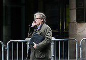 Steve Bannon, chief strategist for United States President-elect Donald Trump, makes a phone call in the street next to the Trump Tower, New York, New York, December 9, 2016.<br /> Credit: Aude Guerrucci / Pool via CNP