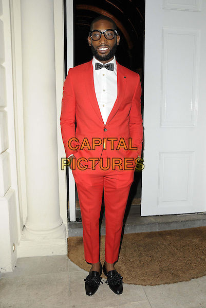 Tinie Tempah ( Patrick Chukwuemeka Okogwu ).The London Collections: Men GQ Dinner, Sketch bar & restaurant, Conduit St., London, England..January 9th, 2013.full length black bow tie red tuxedo white shirt glasses hands in pockets beard facial hair .CAP/CAN.©Can Nguyen/Capital Pictures.